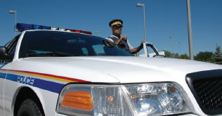 RCMP Officer with cruiser